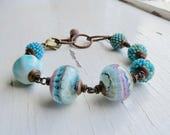 Seascape - handmade artisan bead bracelet with artisan handwoven and lampwork glass in shades of blue-green, aqua, turquoise  - Songbead, UK