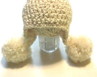 Ready to ship 0-3 month baby girl winter hat.  Cream colored trendy winter baby ear flap hat with large pom poms.