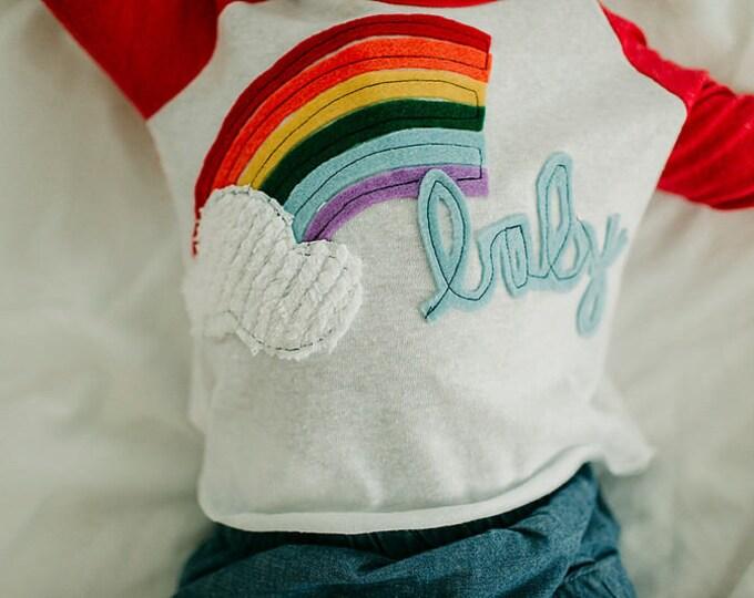 "Swanky Shank ""Rainbow Baby"" Baseball Tee"