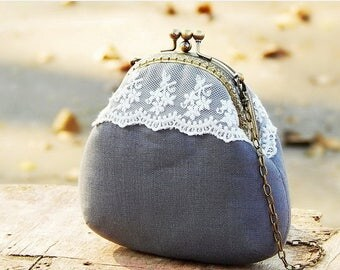 Gray linen kiss lock clutch two compartment