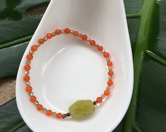Orange beaded bracelet w/ lime green gemstone pendant