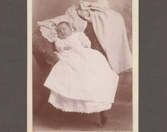 Cabinet Card of an Infant and Its Wardrobe