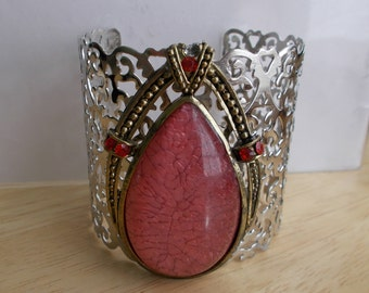 Silver Tone Cuff Bracelet with a Gold Tone and Pink Teardrop Stone
