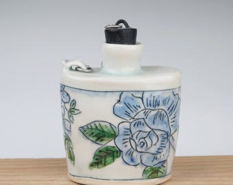 Handmade thrown blue and white porcelain toile/floral pattern flask