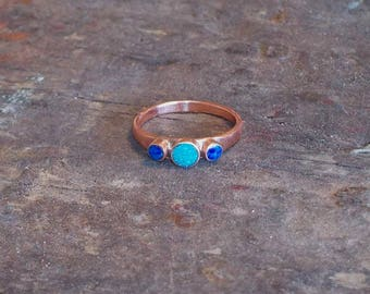 Repurposed copper pipe and tubing mounted to Kingman turquoise and lapis bezel rings