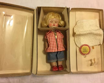 Vintage Vogue Ginny doll in her travel suitcase