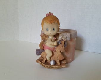 With blue eyes and red hair this adorable baby girl on her rocking horse is a unique present for anyone, just add a small plant or succulent