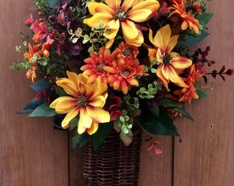 Autumn Wall Basket of Maximilian Sunflowers with Orange Flowers and Red Eucalyptus