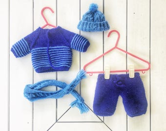 Hand knitted clothing set for doll or teddy