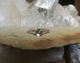 Sterling Silver Flower ring with a 9ct centre.
