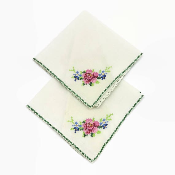 2 vintage embroidered napkins, white luncheon size with cross stitched flowers in one corner, circa mid 20th century, 11 inches square