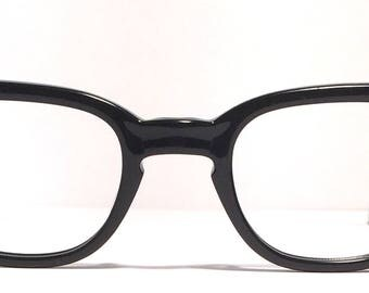 Vintage eyewear. 1960's. Gloss black with silver inlay. Cool Hip style! Excellent quality and condition! Key hole bridge. Mid century style.