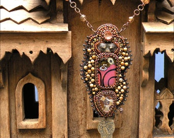 Bear as Seen Through a Glade Darkly | Bead embroidered pendant in earthy colors with Laura Mears porcelain eyes, Lyn Owen fused glass focal