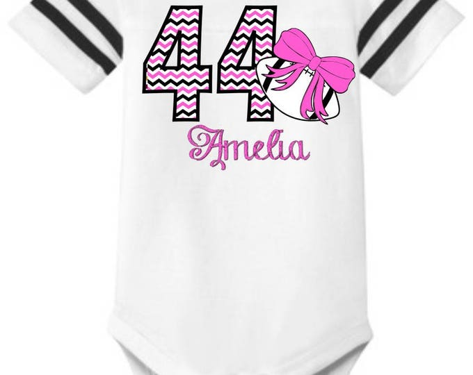 "Personalized Baby Girl's Football STRIPED SLEEVE Onesie One-piece body suit with ""Chevron"" Number, Name, and Print Color of your choice"