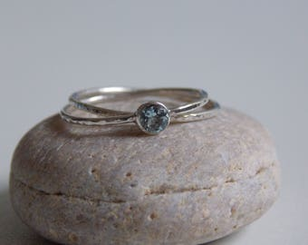 Ring 2 rings in silver entwined and hammered with an aquamarine set stone.