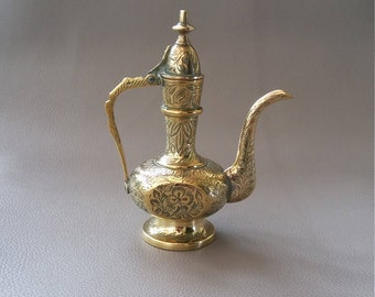 A decorative, Engraved Brass Teapot with Hinged Lid, and Swan Neck pouring spout from India