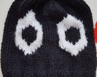 Child's Eyes Beanie hat, Designed, Hand knitted, Black chunky yarn, White eyes iridescent Green in yarn, Gift, Treat, Unique Child's hat.
