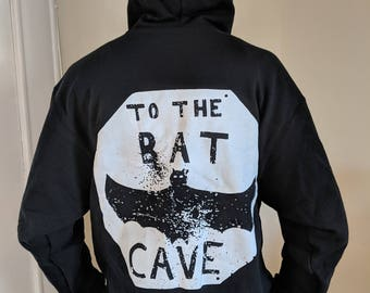 To The Bat Cave Baltimore Skate Hoodie by Adam Stab