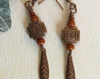 Dark orange/adobe tribal dangle earrings.