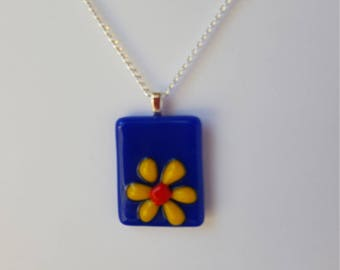 Yellow and Orange daisy on Royal Blue rectangle