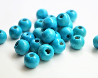 Set of 50 Natural wood beads, light blue painted, smooth round, 10 mm