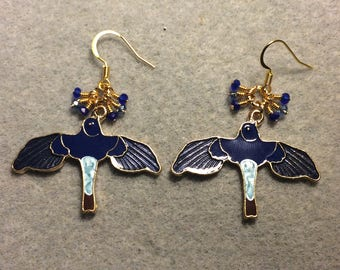 Dark and light blue enamel flying bird charm earrings adorned with tiny dangling dark and light blue Chinese crystal beads.
