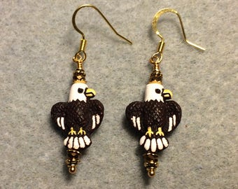 Small brown, white, and yellow ceramic eagle bead earrings adorned with brown gold Chinese crystal beads.