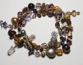 Bohemian bracelet with charms, three rows,