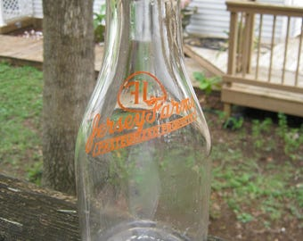 Jersey Farms Milk Bottle, Clear Glass Bottle With Red Orange Lettering, One Quart Bottle, Embossed Property of Jersey Farms