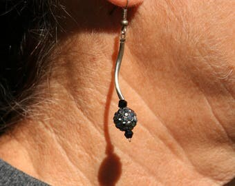Earrings with black rhinestones and silver color tubes