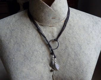 Multi strands with rings and silver leaf necklace