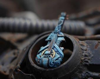 Steampunk Necklace Cello in blu.