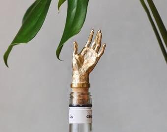 Hand. Bottle stopper