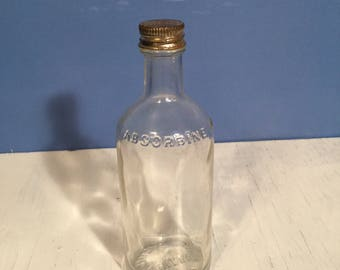 Old Absorbine Jr Liniment Bottle with original screw cap 4 Fl ounces W F Young Inc Montreal Canada