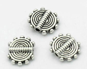 10 flat beads worked silver 10X8mm