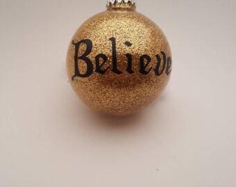 "Gold glitter ""believe"" Christmas tree bulb"