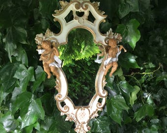 Lovely rare cherrub mirror - such a lovely shape!!