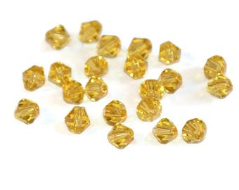 20 clear 6mm yellow glass beads