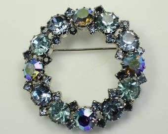 Karu Arke Sparkling Blue Rhinestone Wreath Pin