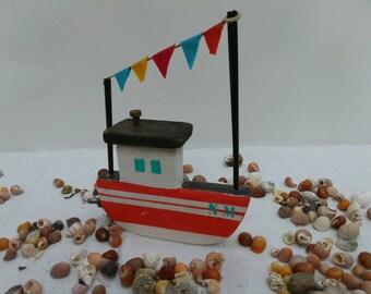 Peach, orange and white boat, reclaimed wood.