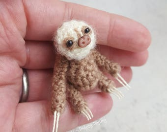 Miniature, baby, sloth, jointed, two toed sloth.
