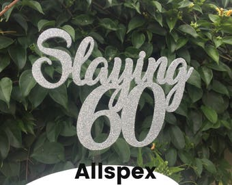60th Birthday Cake Topper reads: Slaying 60