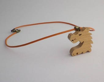 orange dragon in cherry wood and leather pendant