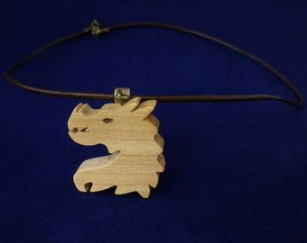 dragon in cherry wood and brown leather pendant