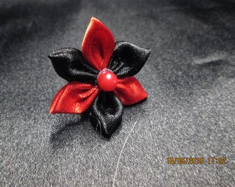 pretty Adjustable ring with a red and black satin flower