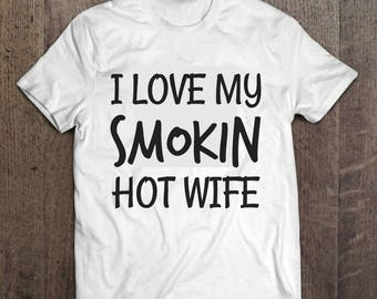 I Love My Smokin Hot Wife Basic Gildan Tee! Perfect gift for your hubby! Available in a variety of colors and sizes!
