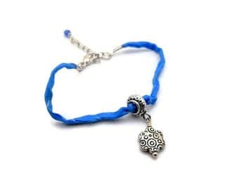 Blue and silver silk and charm bracelet