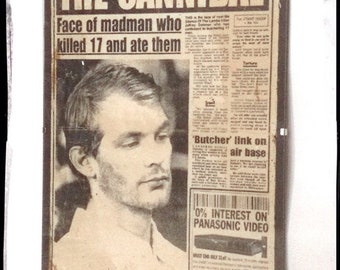 Aged Reproduction Jeffrey Dahmer newspaper story in clip frame.