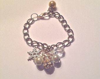 Grey and beige tones charm bracelet.