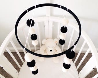 Black and white felt ball cot mobile 'The Monochrome one'